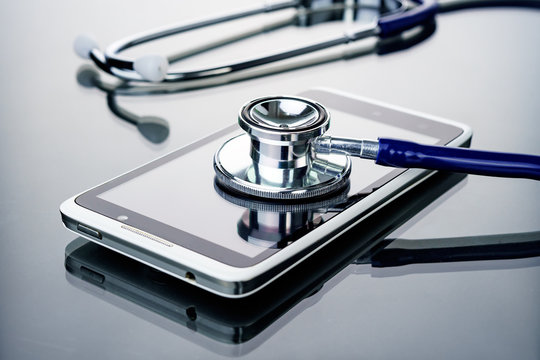 Phone repair and service concept.Smartphone being diagnosed with a stethoscope.