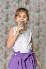 Beautiful little girl with microphone