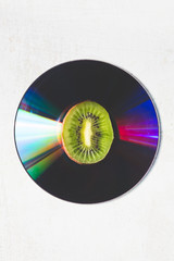 abstract composition of kiwi and cd audio, minimal concept