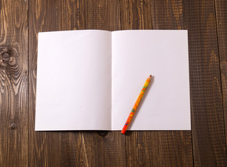 Blank sheet with a pencil