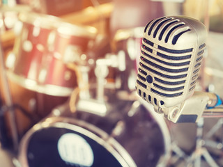 Microphone in a recording studio or concert hall with drum.