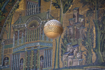 Suspended sphere in front of the mosaic background in the Omayyad mosque