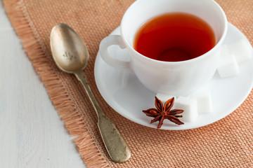 cup of tea with teaspoon