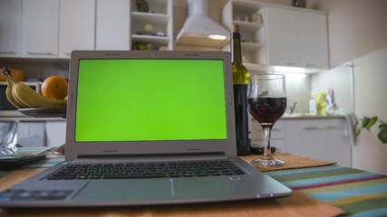 Laptop on the kitchen table