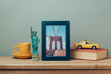 Travel to New York, USA concept with poster mock up template and souvenirs on wooden table