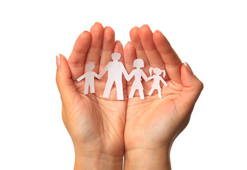 Paper family in hands isolated on white background