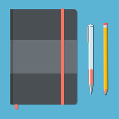 Closed notebook with pencil and pen