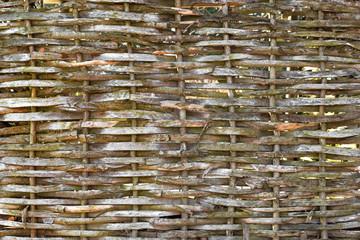 Hintergrund geflochtene Äste Holzwand