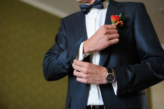 Man cufflink buttons on a white shirt