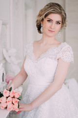 Portrait of bride in flower decor, studio photo. Beautiful Bride portrait wedding makeup and hairstyle, fashion bride model jewelry and beauty girl face, gorgeous beauty bride, studio, flower series