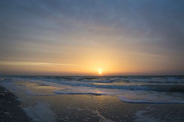Beautiful sunrise at sea, waves, beach
