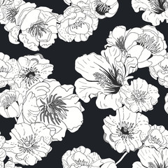 Seamless floral background. Isolated black and white flowers on black background.