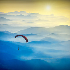 Paraglide silhouette in a light of sunrise