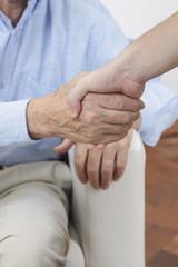senior gentleman shaking hands