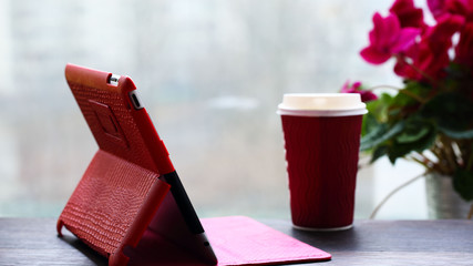 Tablet PC, coffee , window with a flower