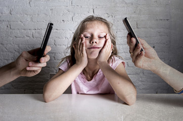 hands of network addict parents using mobile phone neglecting little sad ignored daughter bored