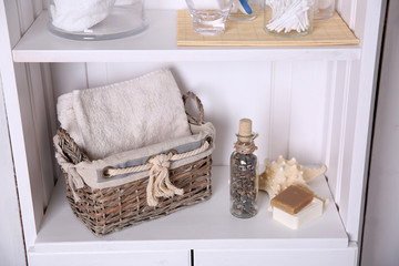 Bathroom set with towel, starfish and soap on a light shelf
