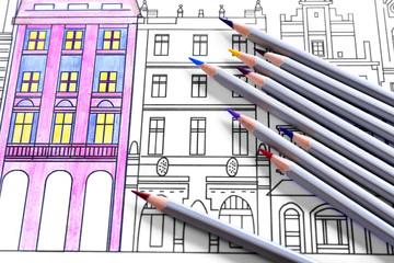 Adult anti stress coloring with crayons closeup