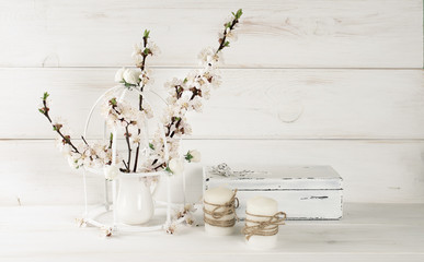 Apricot flowers with candle and old casket in Shabby Chic style