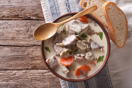Beef with mushrooms in cream sauce in a bowl. horizontal top view