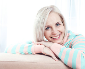 Active beautiful middle-aged woman smiling friendly and looking into the camera.