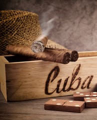 Smoking cigar and domino game, Cuba.