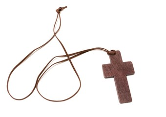 Brown crucifix isolated on white background.