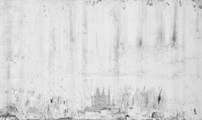 Grungy white concrete wall with traces of plaster