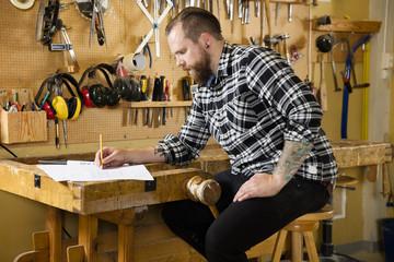 Carpenter planning new work in the workshop