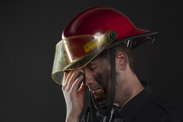 image of tired fire fighter