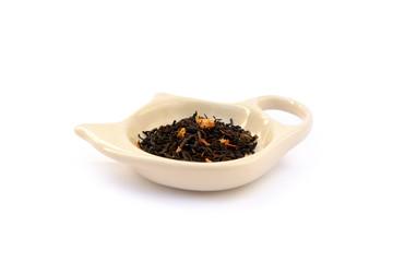 Tea on the tea saucer isolated on white background