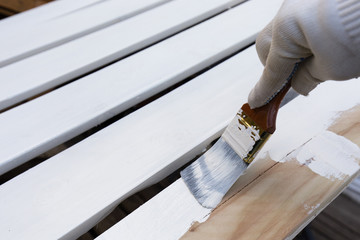 Painting timber boards with white paint