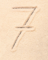7 number written on sand