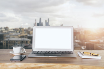 Laptop on city background