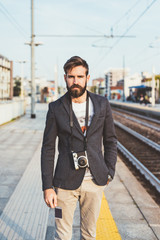 young handsome caucasian bearded man photographer