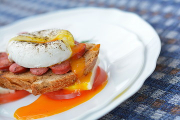 Orange yolk of poached egg