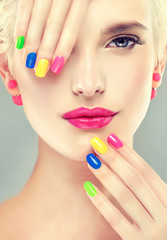 Tuinposter Beauty colorful makeup and manicure nails . Stylish blonde girl with bright makeup and colorful nail Polish on your nails . Spring and summer look and Earrings beads
