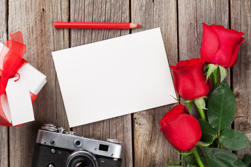 Valentines day roses, photo frame and camera