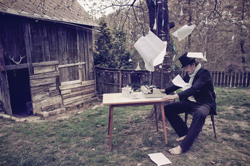 Vintage Outdoor Writer is Writing a Novel Book on Typewriter
