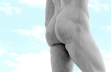 detail of the back of the marble statue with muscular legs