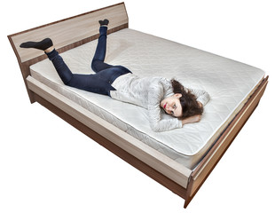One young Caucasian woman relaxing on spring mattress wooden bed.