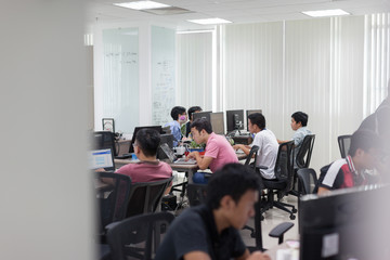 Asian Software Developers Office Team Sitting At Desk