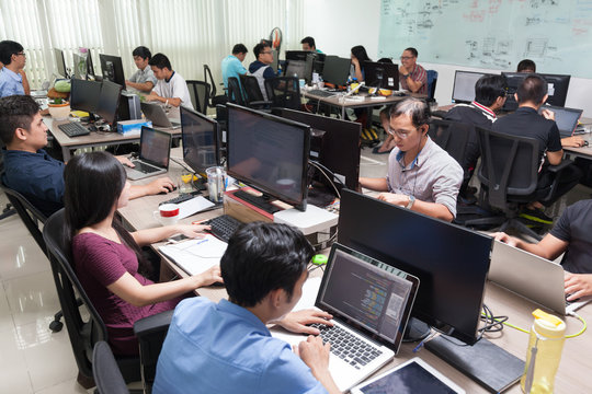 Asian Software Developers Business People Sitting Desk Working