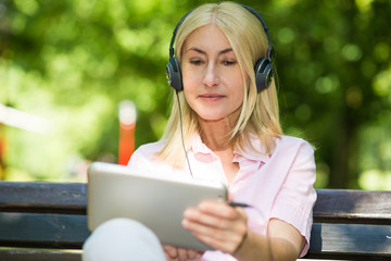 Mature woman listening music