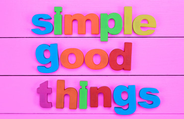 Words Simple Good Things on pink table