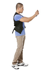 guy standing while taking picture using phone