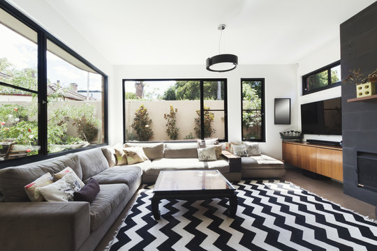 Black and white scheme living room with wood and grey tiling acc