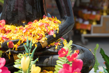 Buddha with flowers that lap