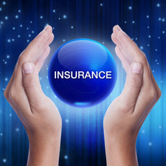 Hand showing blue crystal ball with insurance word. business concept