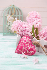 Hyacinths flowers in wooden box and decorative  red heart